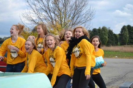 The JV volleyball team was bumping and jumping all along the parade route!