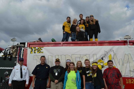 Members of The ThunderHawk staff got to ride on, or rollerblade next to, a fire truck from Overisel Fire Deparment driven by Officers Scholten and Horsting.