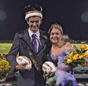 King Brad Dekker and Queen Emma VanSlooten pose after being crowned Hawkeye royalty at halftime of the Homecoming game Oct. 9, against Holland.