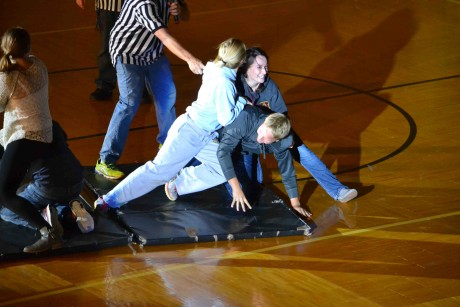 "Freshman Jess Rockhold battles senior Helena Sharar for the right to sit on one of the final two ""chairs"" - Kyle DeNeef."